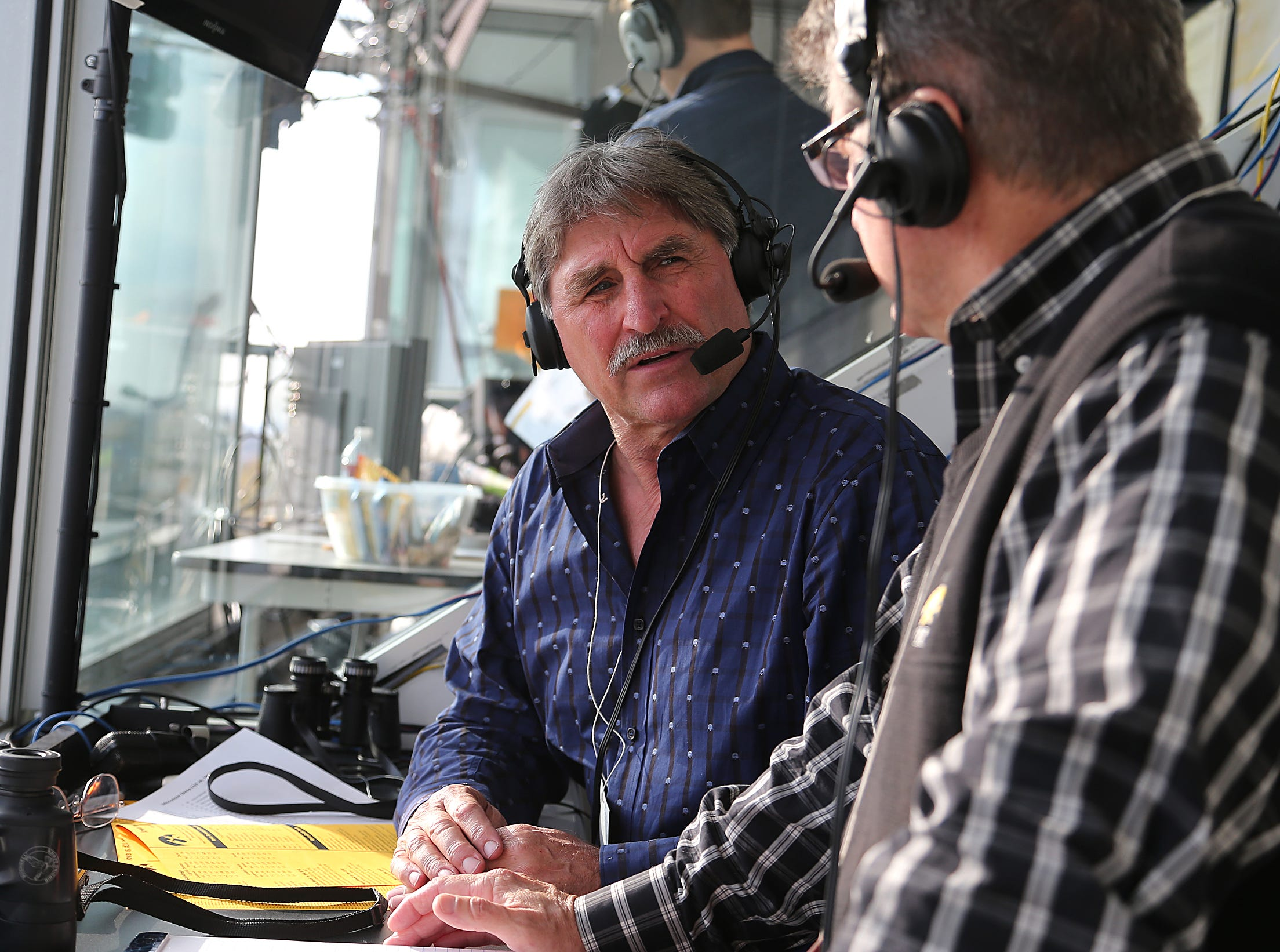 From 2013: Ed Podolak, left, talks with Iowa play-by-play announcer Gary Dolphin prior to kickoff against Wisconsin in 2013.