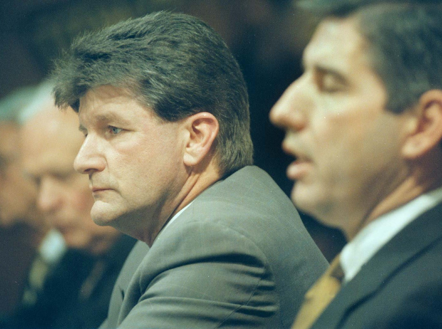 From 1996: Gary Dolphin listens as University of Iowa Athletic Director Bob Bowlsby, right, responds to a question during a news conference after Dolphin was named the new radio play-by-play announcer for the university and Learfield Communications, Inc. In background are Jim Zabel (left) and Bob Brooks.