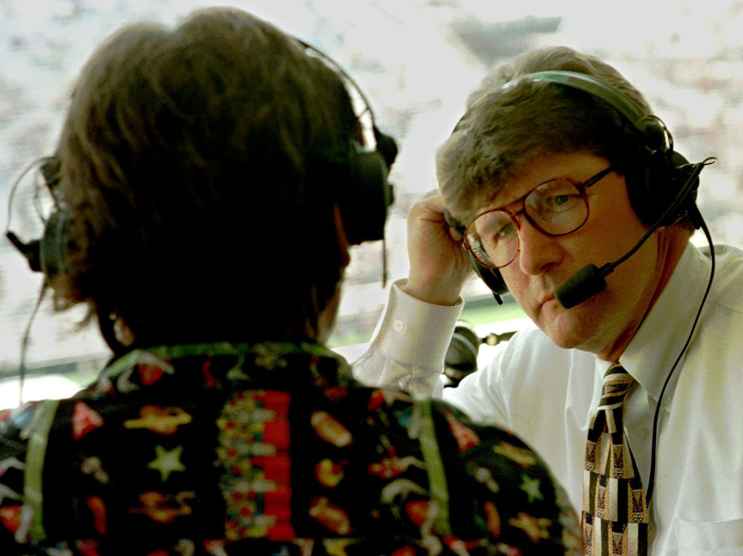 """From 1997: Gary Dolphin listens to color commentator Ed Podolak during Dolphin's first game as the exclusive radio voice of Iowa football. """"I'm pretty well drained,"""" he said after calling Iowa's 66-0 rout of Northern Iowa. """"I'm ecstatic to get the first one out of the way."""""""