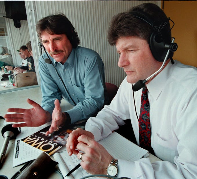 From 1997: Ed Podolak, left, works with new Iowa football play-by-play announcer Gary Dolphin before a Hawkeye spring football game.