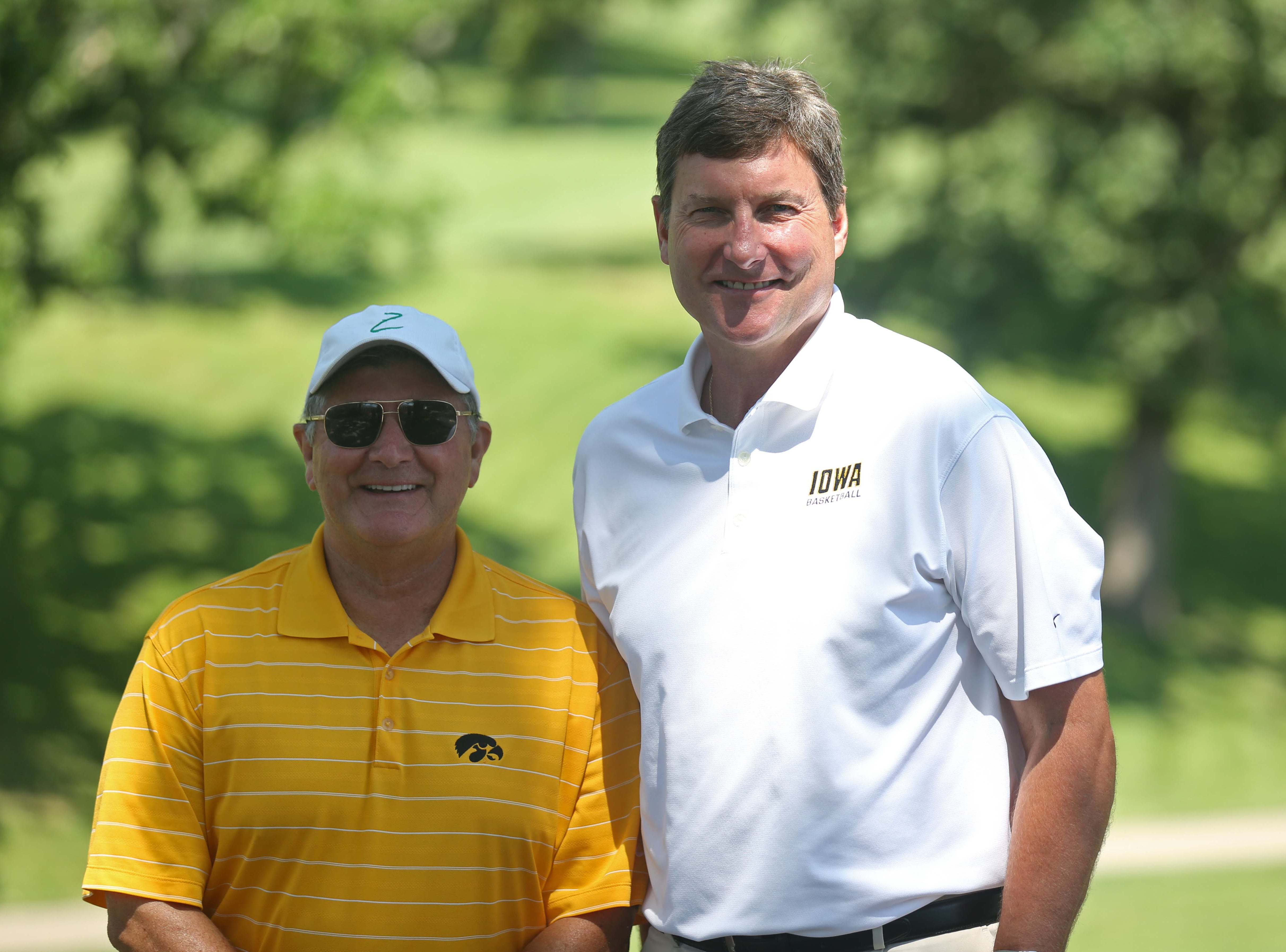 Gary Dolphin and Bobby Hansen, radio announcers for the University of Iowa basketball team pose for a photo during the annual Polk County I-Club golf fundraiser at Wakonda Club in Des Moines on Monday, June 13, 2015.