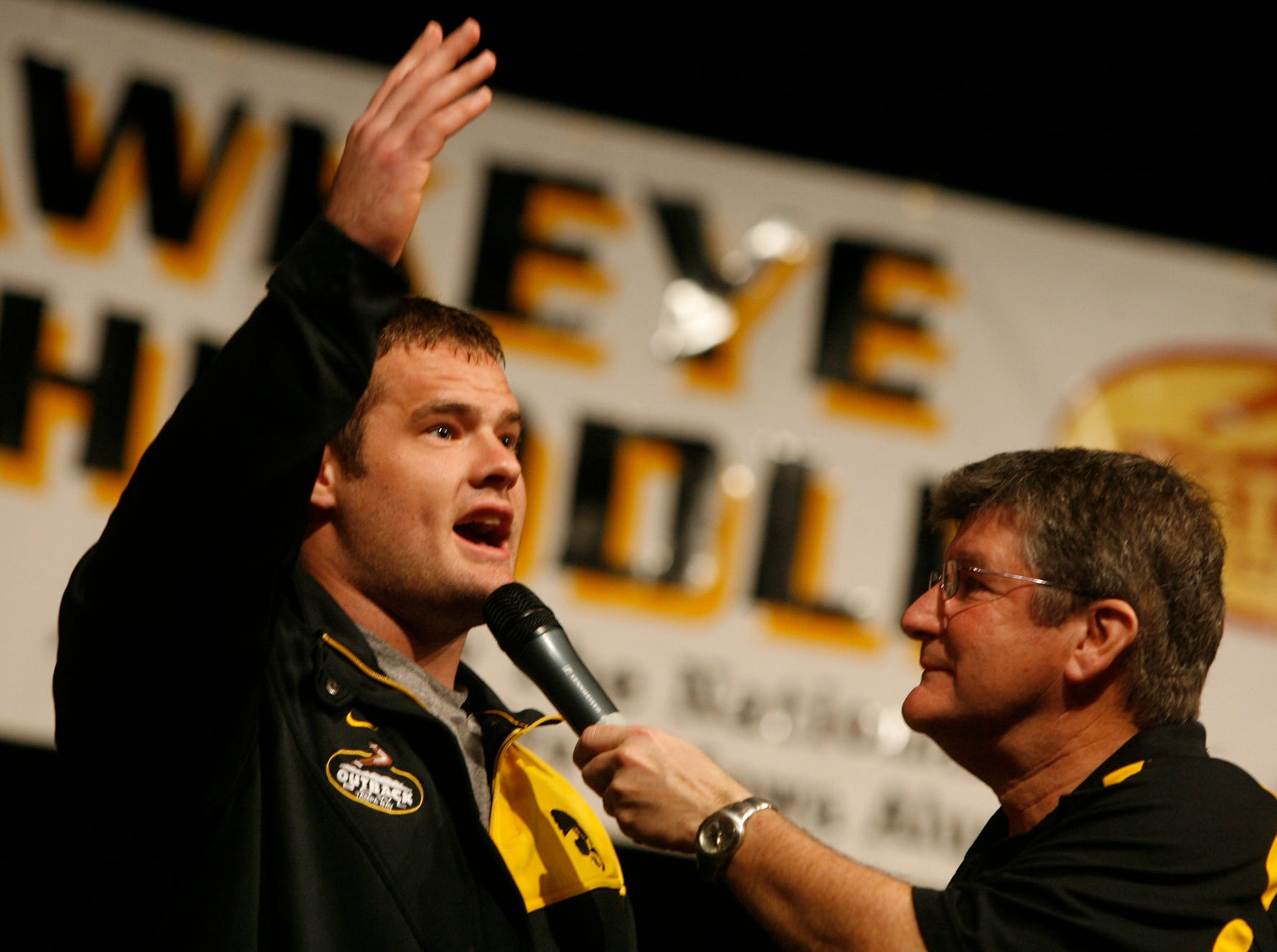 From 2008: Iowa's Matt Kroul thanks the fans while talking with Gary Dolphin during the Hawkeye Huddle  in Tampa, Fla.