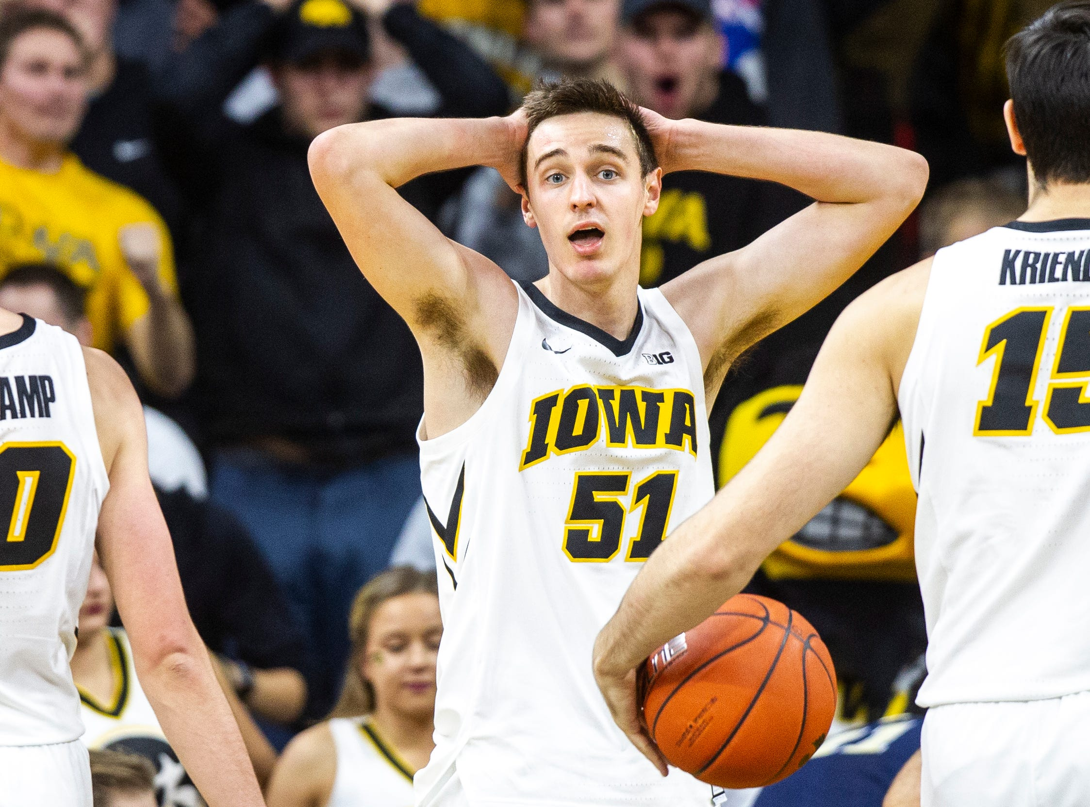 Iowa forward Nicholas Baer (51) reacts after getting called for a foul during a NCAA men's basketball game on Tuesday, Nov. 27, 2018, at Carver-Hawkeye Arena in Iowa City.