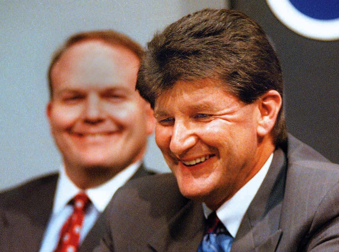 From 1996: Gary Dolphin of Dubuque was named play-by-play radio announcer for University of Iowa football and men's basketball games Friday. Behind him is Roger Gardner, vice president of Learfield Communications, which owns the games' broadcast rights.
