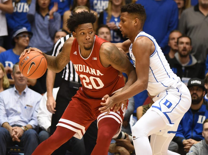 Nov 27, 2018; Durham, NC, USA; Indiana Hoosiers forward D'Ron Davis (20) drives to the basket as Duke Blue Devils forward Javin DeLaurier (12) defends during the first half at Cameron Indoor Stadium.