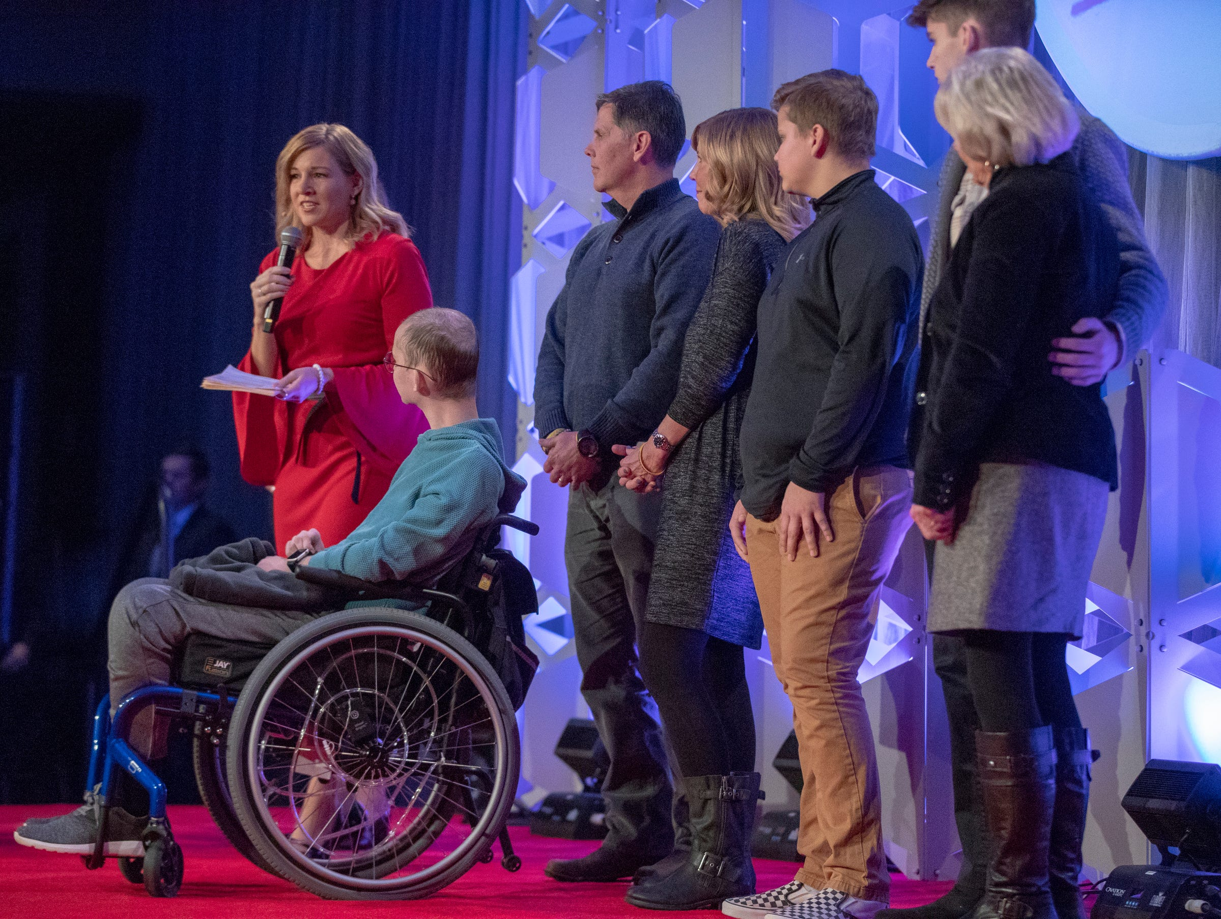 Tyler Trent (in wheelchair) is introduced at a fundraiser luncheon for Riley Children's Foundation's Be The Hope Now campaign, Indianapolis, Wednesday, Nov. 28, 2018. Trent, who has the rare bone cancer osteosarcoma, is in hospice care, and was given the Sagamore of the Wabash award, given to distinguished Hoosiers.