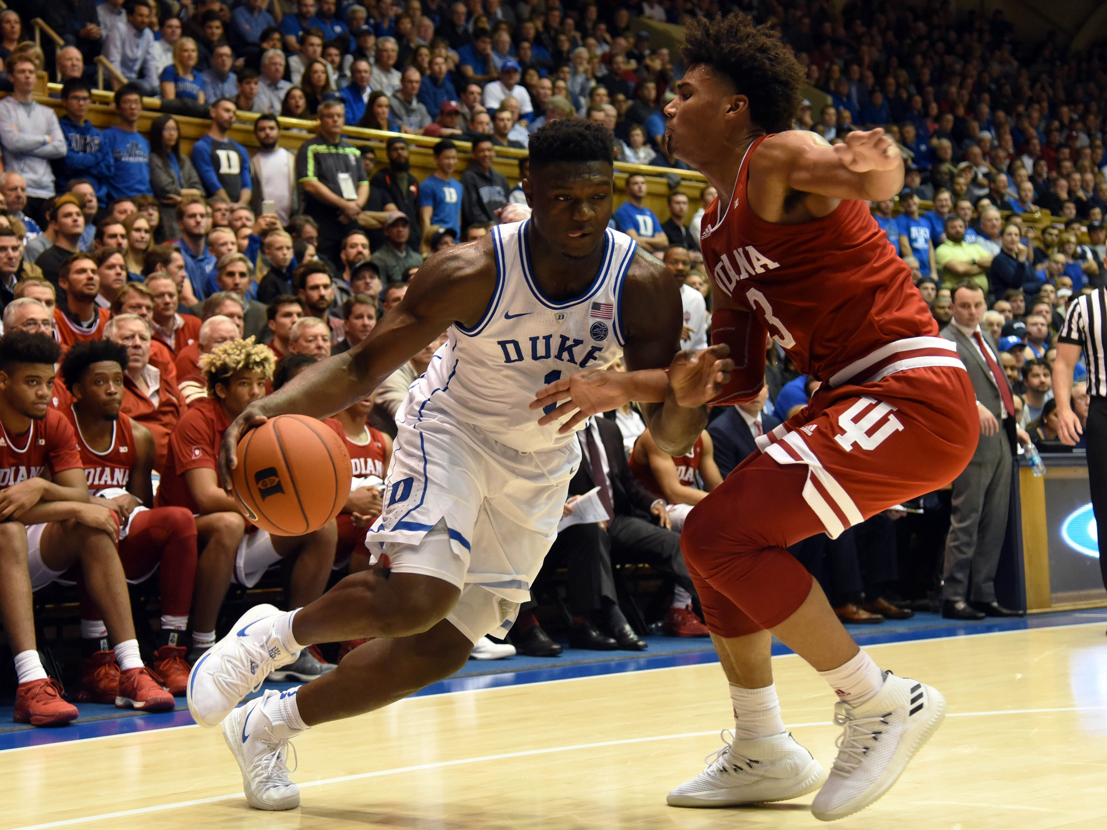 Nov 27, 2018; Durham, NC, USA; Duke Blue Devils forward Zion Williamson (1) drives to the basket past Indiana Hoosiers forward Justin Smith (3) during the first half at Cameron Indoor Stadium.