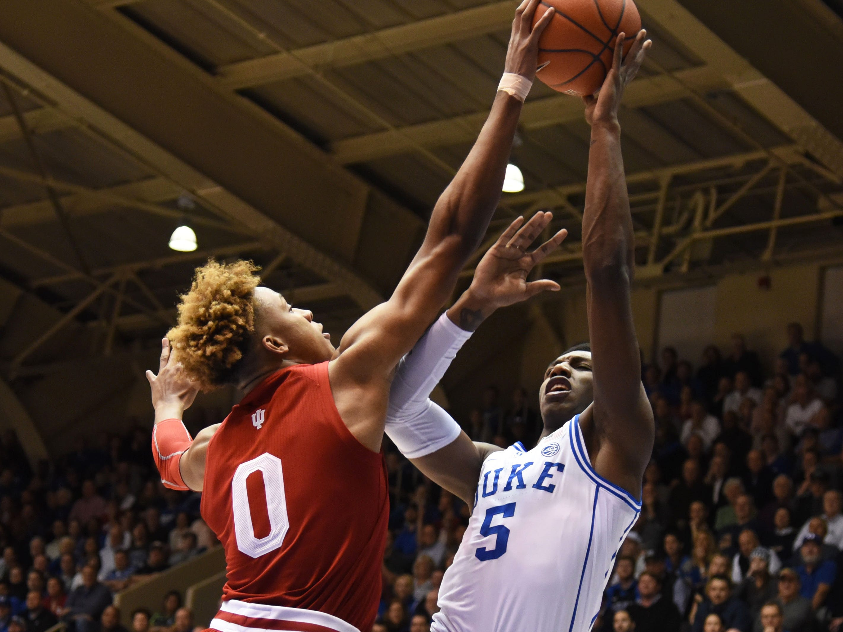 Nov 27, 2018; Durham, NC, USA; Indiana Hoosiers guard Romeo Langford (0) blocks the shot of Duke Blue Devils forward R.J. Barrett (5) during the first half at Cameron Indoor Stadium.