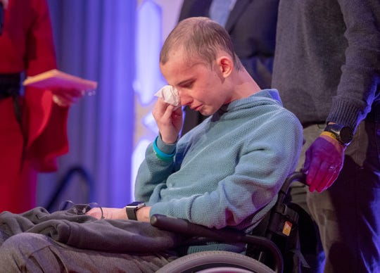 Tyler Trent wipes tears after he was presented with the Sagamore of the Wabash at a fundraiser luncheon for Riley Children's Foundation's Be The Hope Now campaign, Indianapolis, Wednesday, Nov. 28, 2018. Trent, who has the rare bone cancer osteosarcoma, is in hospice care.