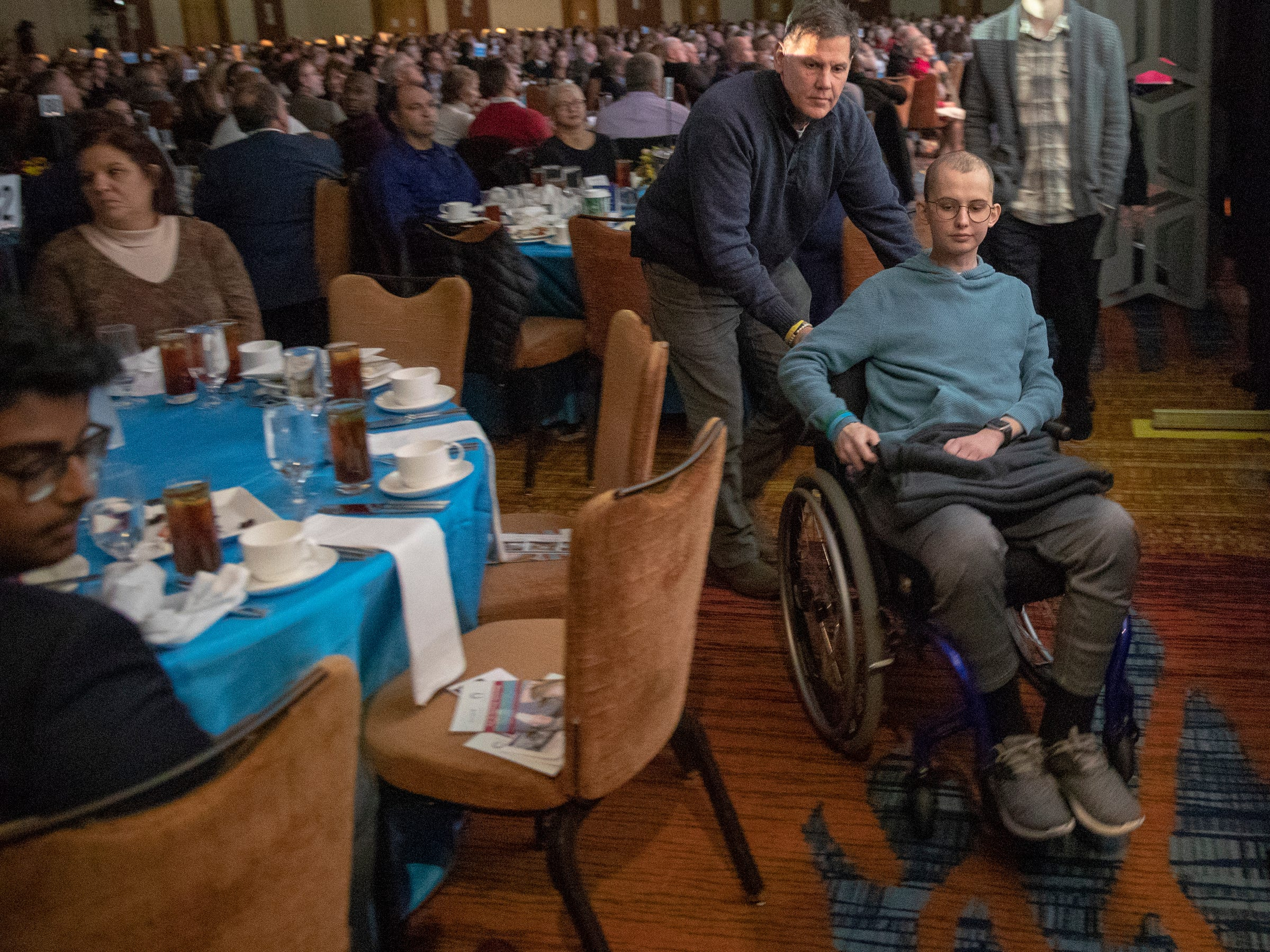 Tyler Trent is pushed by his father Tony Trent, at a fundraiser luncheon for Riley Children's Foundation's Be The Hope Now campaign, Indianapolis, Wednesday, Nov. 28, 2018. Trent, who has the rare bone cancer osteosarcoma, is in hospice care, and was given the Sagamore of the Wabash award, given to distinguished Hoosiers.