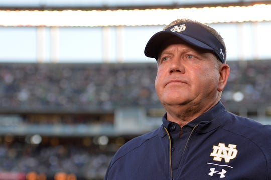 Fighting Irish coach Brian Kelly looks on before the game against the Navy Midshipmen at SDCCU Stadium.