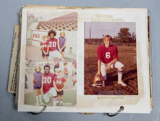 A scrapbook page from Gregg Doyel, showing him with his sister Kathryn, and Oklahoma Sooner players Billy Sims (20), and Kenny King (30), who played with David Overstreet I.