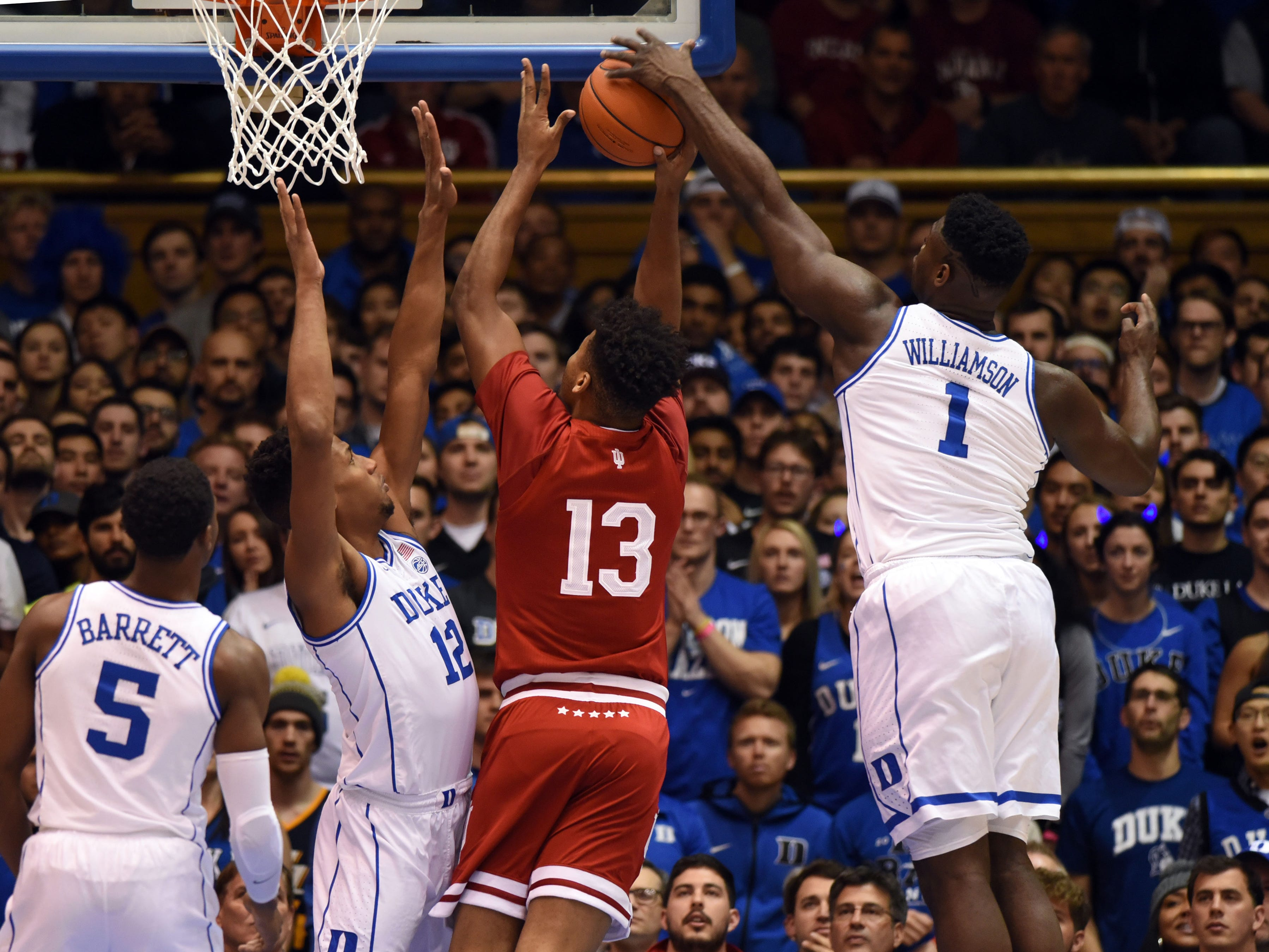 Duke Blue Devils forward Zion Williamson (1) blocks the shot of Indiana Hoosiers forward Juwan Morgan (13) during the first half at Cameron Indoor Stadium.