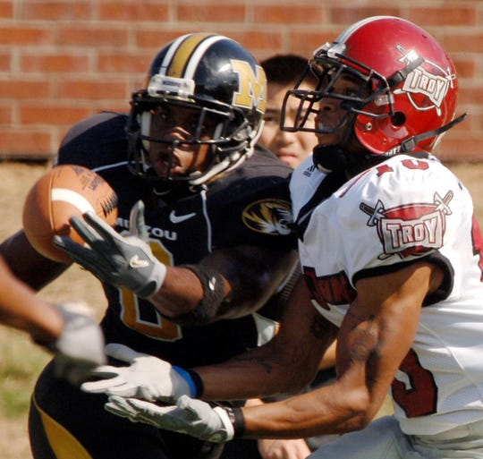 Missouri safety David Overstreet II, left, broke up a pass to Troy receiver James Earl Cray, right,  on Sept. 17, 2005, during Missouri's 52-21 victory in Columbia, Mo.