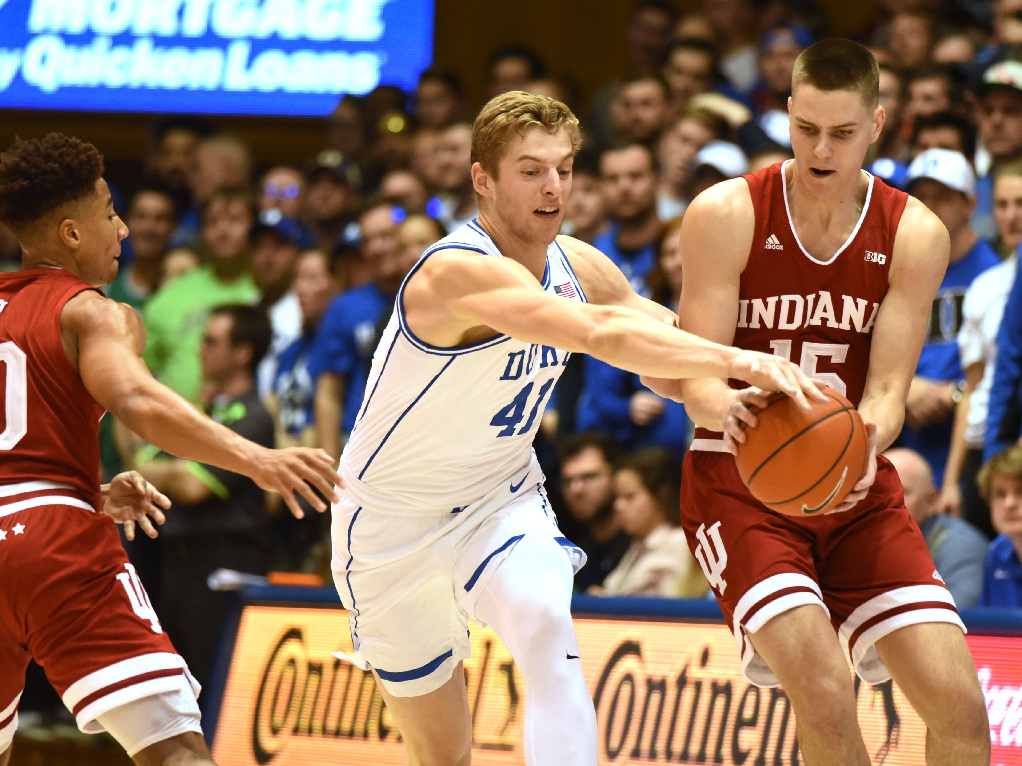 Nov 27, 2018; Durham, NC, USA; Duke Blue Devils forward Jack White (41) attempts to steal the ball in front of Indiana Hoosiers forward Evan Fitzner (55) during the first half at Cameron Indoor Stadium.
