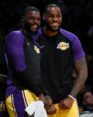 Los Angeles Lakers forward LeBron James, right, celebrated with teammate -- and former Pacers adversary --  Lance Stephenson after a dunk by Johnathan Williams earlier this season.