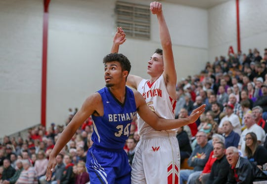 Bethany  Christian standout  KeShawn Smith, left, died Saturday in a crash on his way to a basketball recruiting visit at Huntington University.