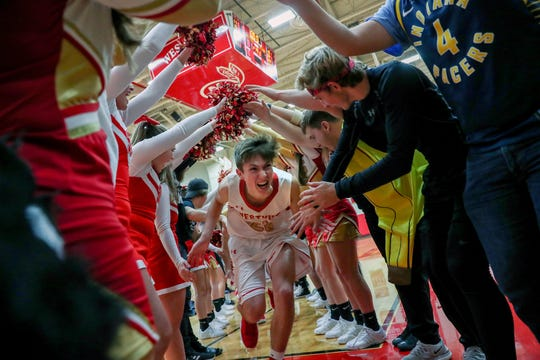 Westview's Drew Litwiller (25) makes his way through a tunnel of students after defeating the Bethany Christian Bruins 81-7 in the first game of the season on Tuesday, Nov. 20, 2018.