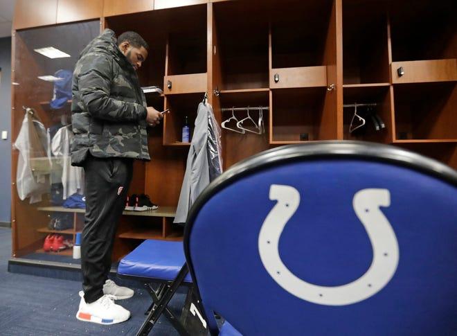 Colts' Jacoby Brissett quarterback Jacoby Brissett checks his phone after a game last season.
