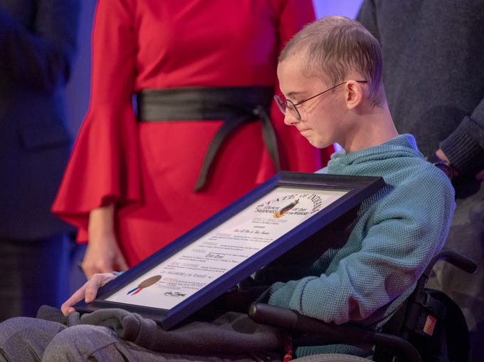 Tyler Trent listens to applause after he was presented with the Sagamore of the Wabash at a fundraiser luncheon for Riley Children's Foundation's Be The Hope Now campaign, Indianapolis, Wednesday, Nov. 28, 2018. Trent, who has the rare bone cancer osteosarcoma, is in hospice care.