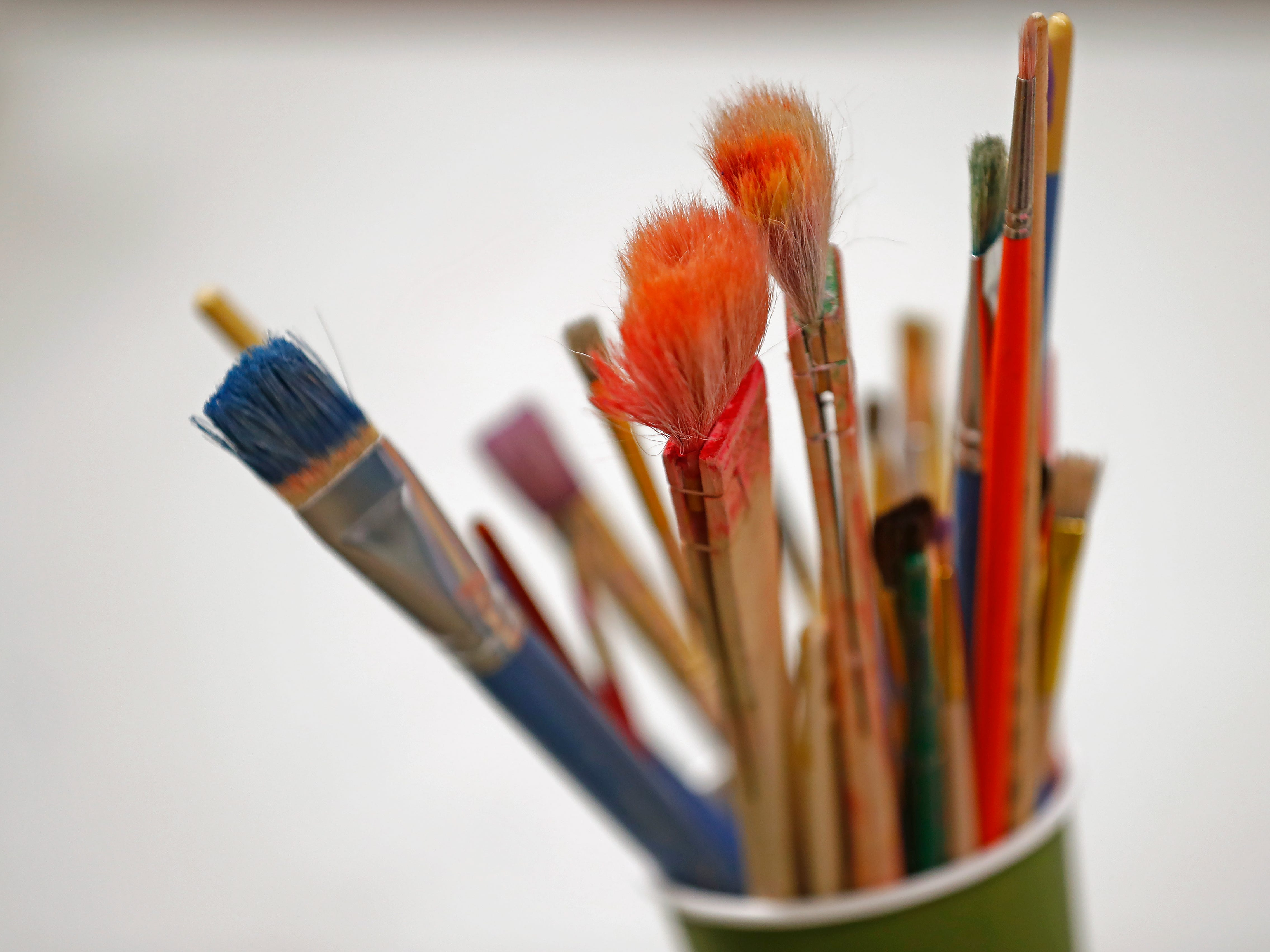 Paint brushes are seen in the Clowes Foundation Art Room at Indiana Youth Group, Tuesday, Nov. 27, 2018.  The organization offers a safe drop-in center for LGBTQ+ youth, ages 12-20, and their straight ally friends, in the Indianapolis area.  Activities, tutoring, food and clothes pantries are included in the center.