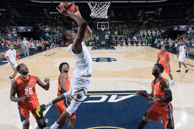 Nov 27, 2018; South Bend, IN, USA; Notre Dame Fighting Irish forward Juwan Durham (11) goes up for a shot in the second half against the Illinois Fighting Illini at the Purcell Pavilion.