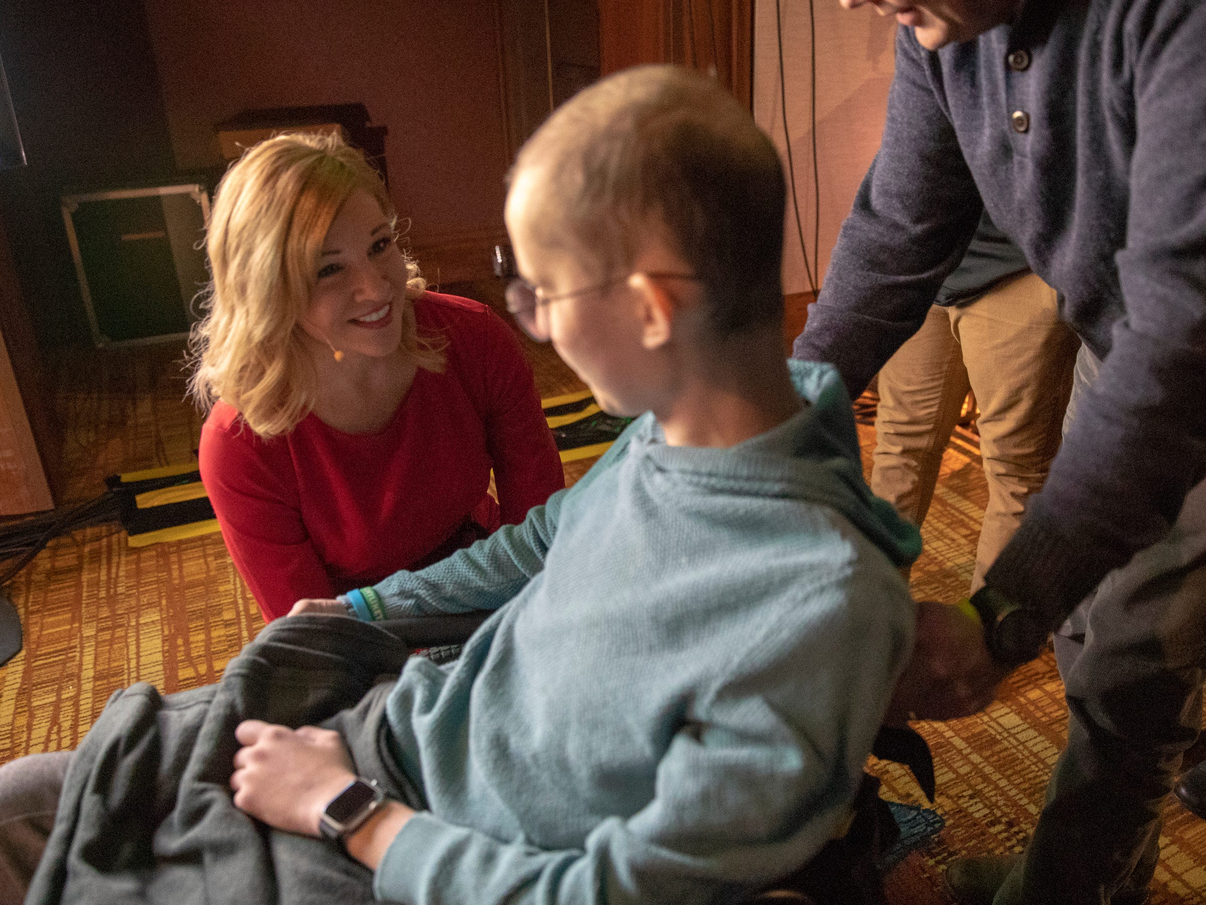 Trisha Shepherd, who is MCing the event, gives encouragement to Tyler Trent at a fundraiser luncheon for Riley Children's Foundation's Be The Hope Now campaign, Indianapolis, Wednesday, Nov. 28, 2018. Trent, who has the rare bone cancer osteosarcoma, is in hospice care, and was given the Sagamore of the Wabash award, given to distinguished Hoosiers.