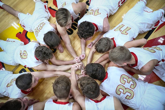 After both teams are announced and before tip, the Westview Warriors chant on the ground near their bench before facing off against the Bethany Christian Bruins in Topeka, Ind., on Tuesday, Nov. 20, 2018.