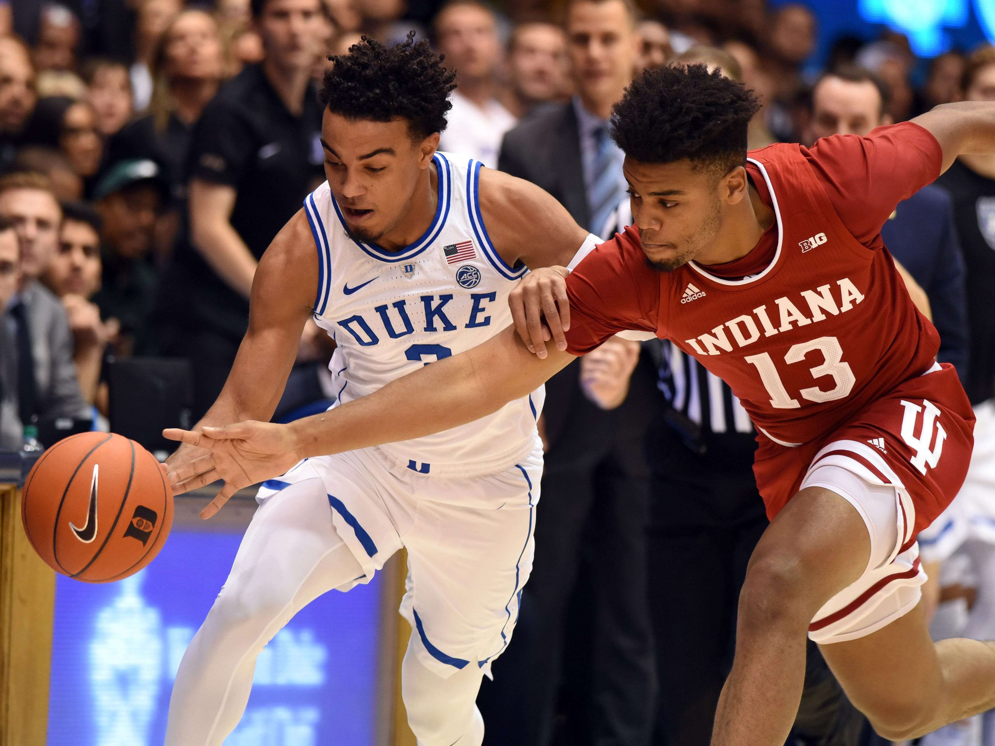 Nov 27, 2018; Durham, NC, USA; Indiana Hoosiers forward Juwan Morgan (13) and Duke Blue Devils guard Tre Jones (3) fight for a loose ball during the first half at Cameron Indoor Stadium.