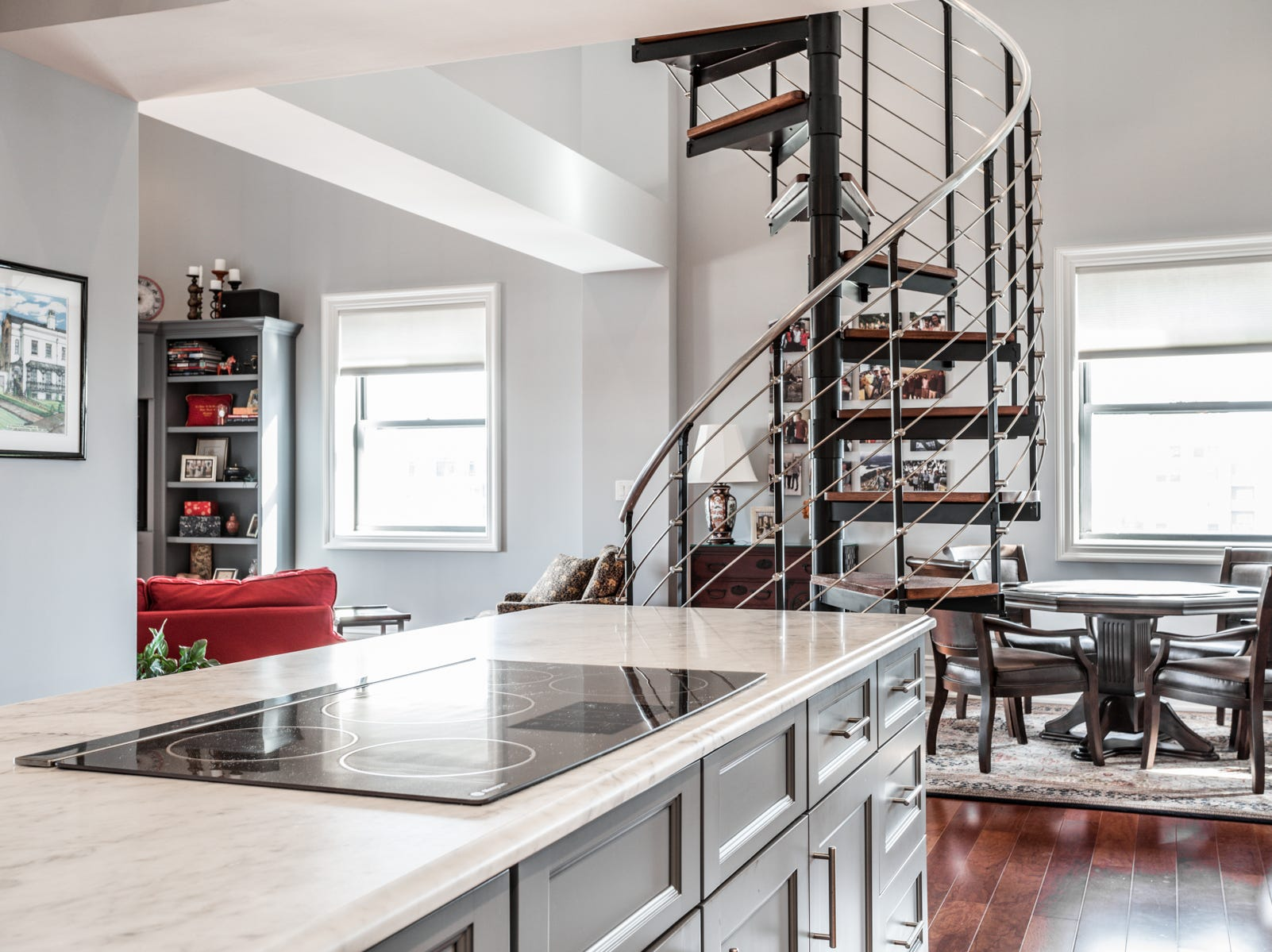 The spiral staircase leads to a loft and storage space.