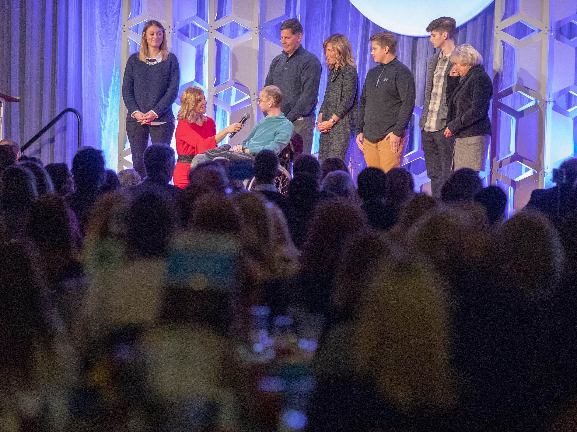 Tyler Trent, with his family, is interviewed at a fundraiser luncheon for Riley Children's Foundation's Be The Hope Now campaign, Indianapolis, Wednesday, Nov. 28, 2018. Trent, who has the rare bone cancer osteosarcoma, is in hospice care, and was given the Sagamore of the Wabash award, given to distinguished Hoosiers.