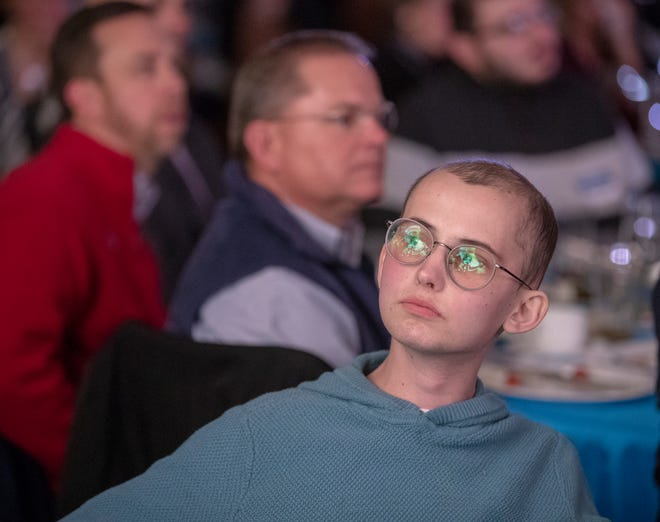 Tyler Trent watches a video feed at a fundraiser luncheon for Riley Children's Foundation's Be The Hope Now campaign, Indianapolis, Wednesday, Nov. 28, 2018. Trent, who has the rare bone cancer osteosarcoma, is in hospice care, and was given the Sagamore of the Wabash award, given to distinguished Hoosiers.