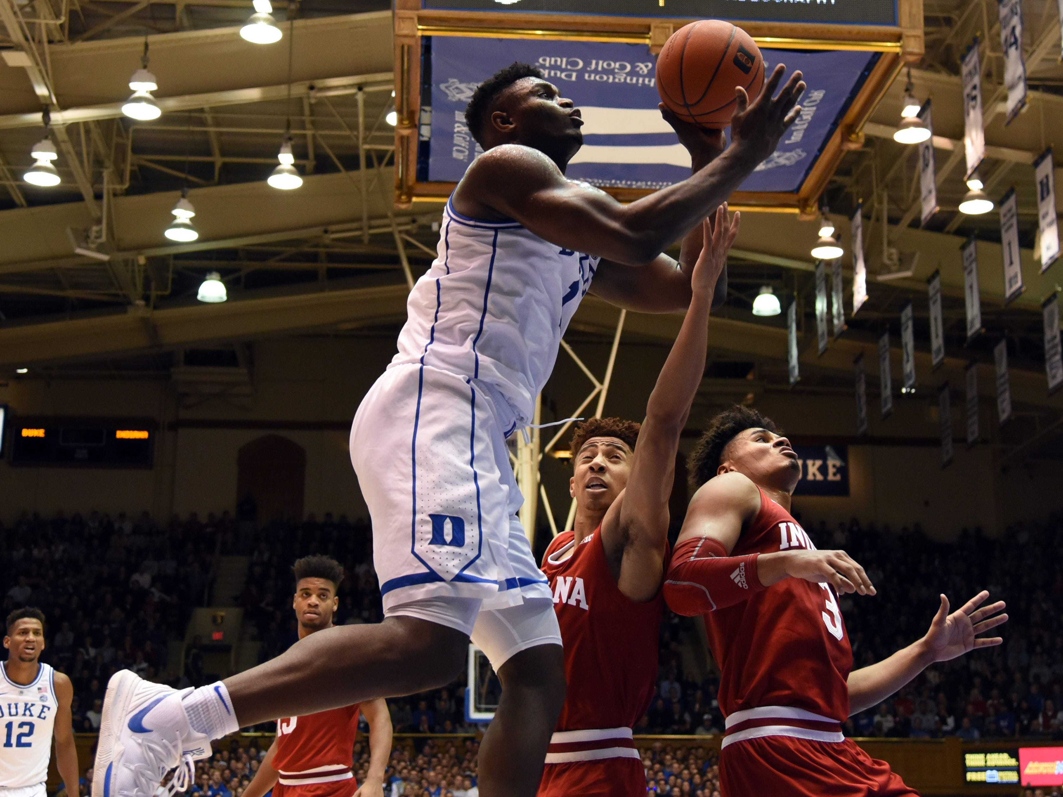 Nov 27, 2018; Durham, NC, USA; Duke Blue Devils forward Zion Williamson (1) shoots over Indiana Hoosiers guard Rob Phinisee (10) during the first half at Cameron Indoor Stadium.
