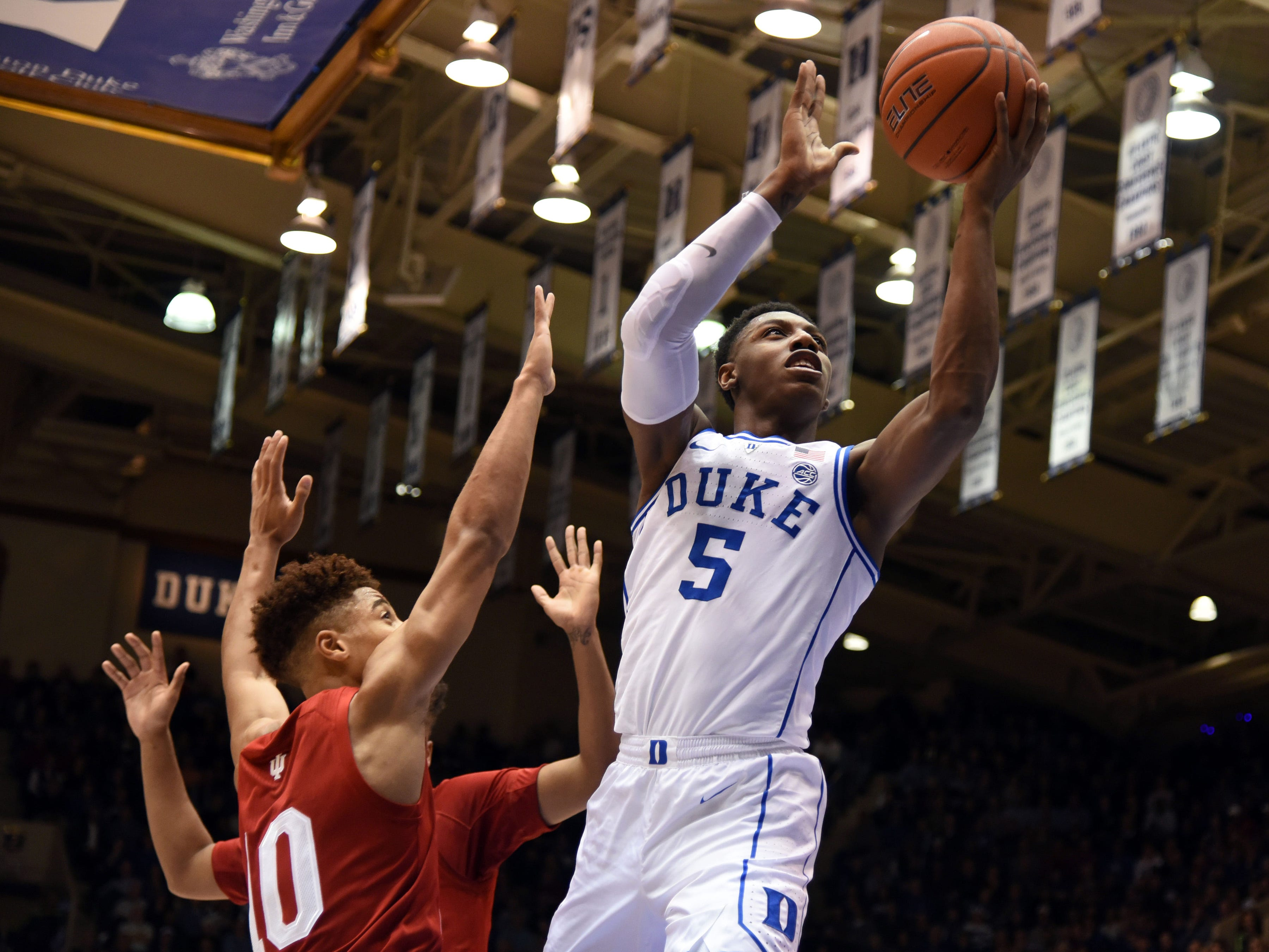 Nov 27, 2018; Durham, NC, USA; Duke Blue Devils forward R.J. Barrett (5) shoots in front of Indiana Hoosiers guard Rob Phinisee (10) during the first half at Cameron Indoor Stadium.