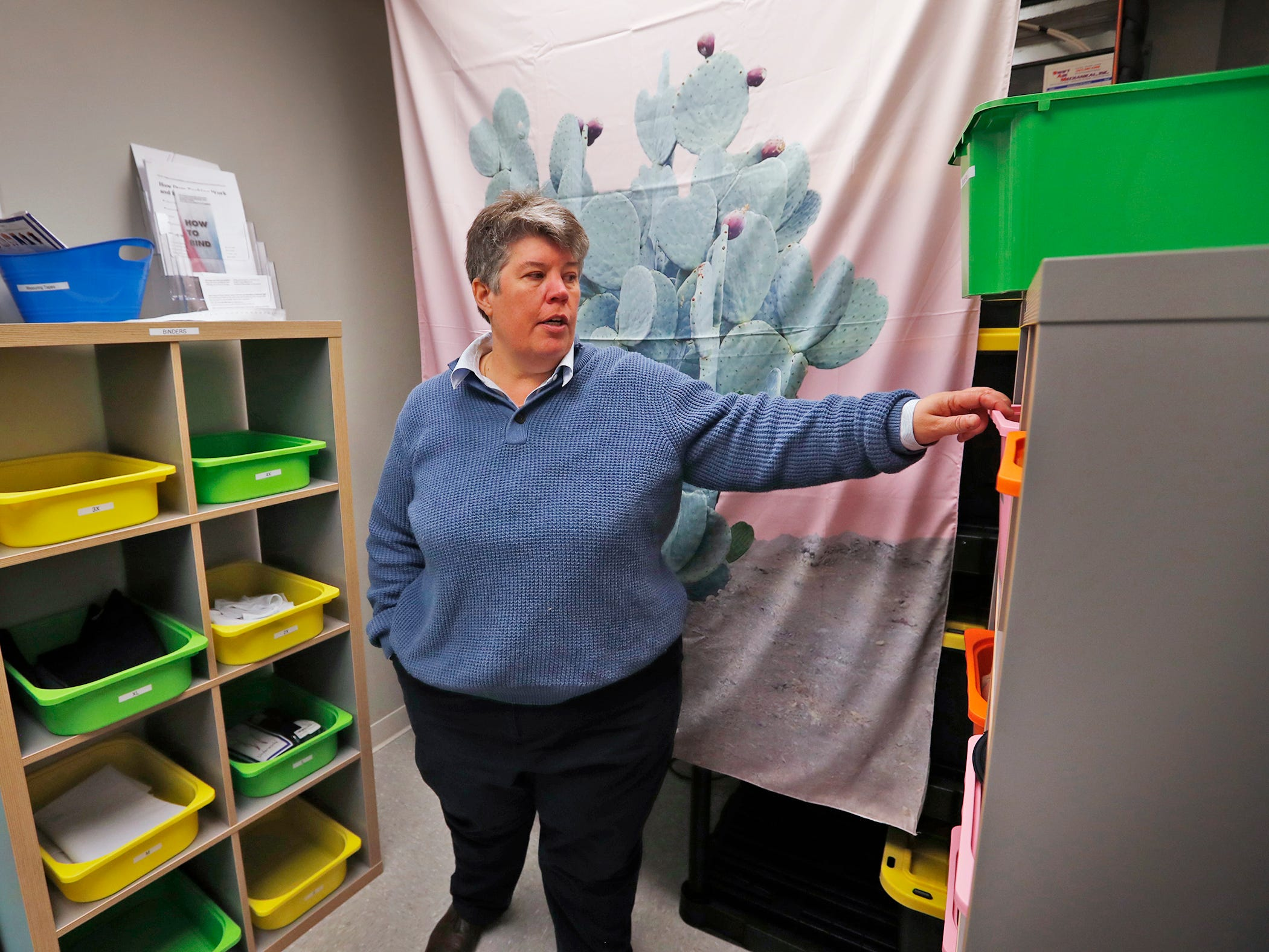 Indiana Youth Group President and CEO Chris Paulsen shows the new Transitional Apparel Room at the Indiana Youth Group center, Tuesday, Nov. 27, 2018.  The organization offers a safe drop-in center for LGBTQ+ youth, ages 12-20, and their straight ally friends, in the Indianapolis area.  Activities, tutoring, food and clothes pantries are included in the center.