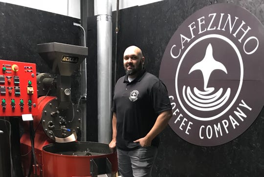 Johni Medeiros of Clinton, owner and president of Cafezinho Coffee Company, shows the commercial roaster used to produce the Cafezinho line of coffee.