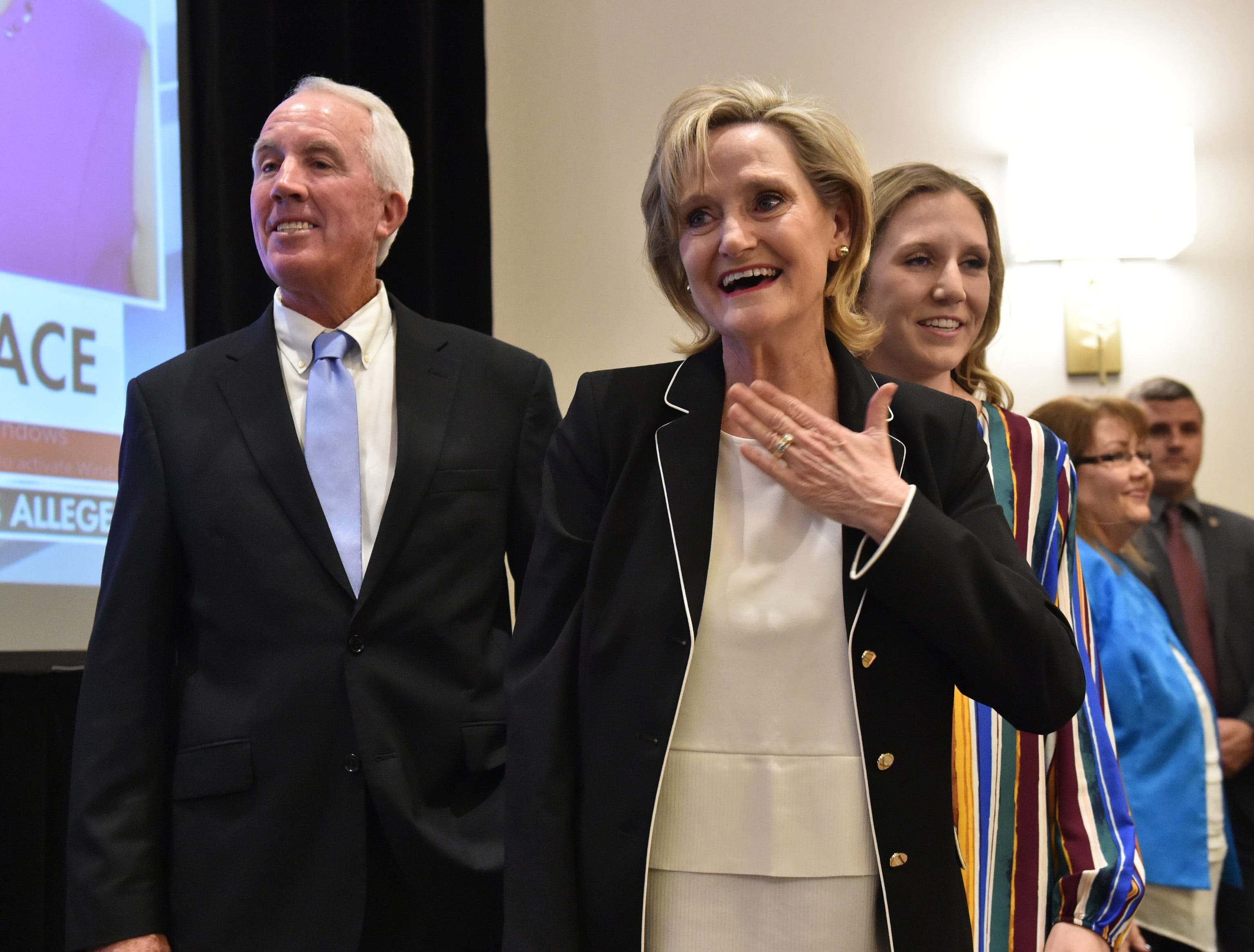 U.S. Sen Cindy Hyde-Smith enters the room of her election watch party at the Westin hotel in Jackson following the announcement of her win against democratic candidate Mike Espy for U.S. senate. Jackson, Miss. Tuesday, Nov. 27, 2018.