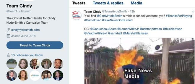 """Team Cindy, the official Twitter of Cindy Hyde-Smith's campaign, tweeted a GIF that depicts the """"fake news media"""" catching on fire over a claim about a yearbook that shows Hyde-Smith attending a private school for white students after schools in Mississippi desegregated. Several journalists were tagged in the Tweet, including Clarion Ledger Executive Editor Sam Hall."""
