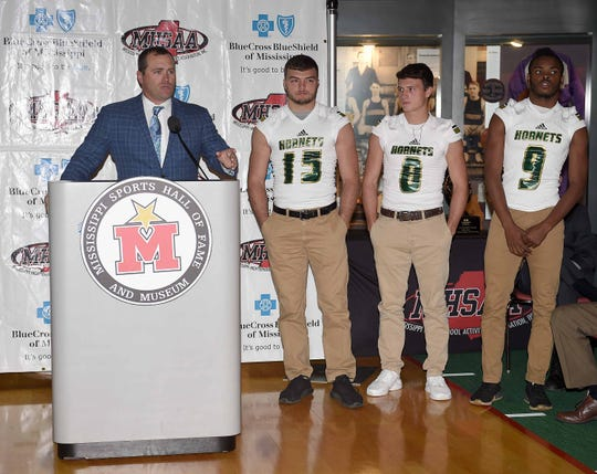 Poplarville head coach Jay Beech introduces players Ross Barnett (15), Tyson Holston (8) and Antonio Barnes (9) at a Monday's state championship news conference at the Mississippi Sports Hall of Fame.