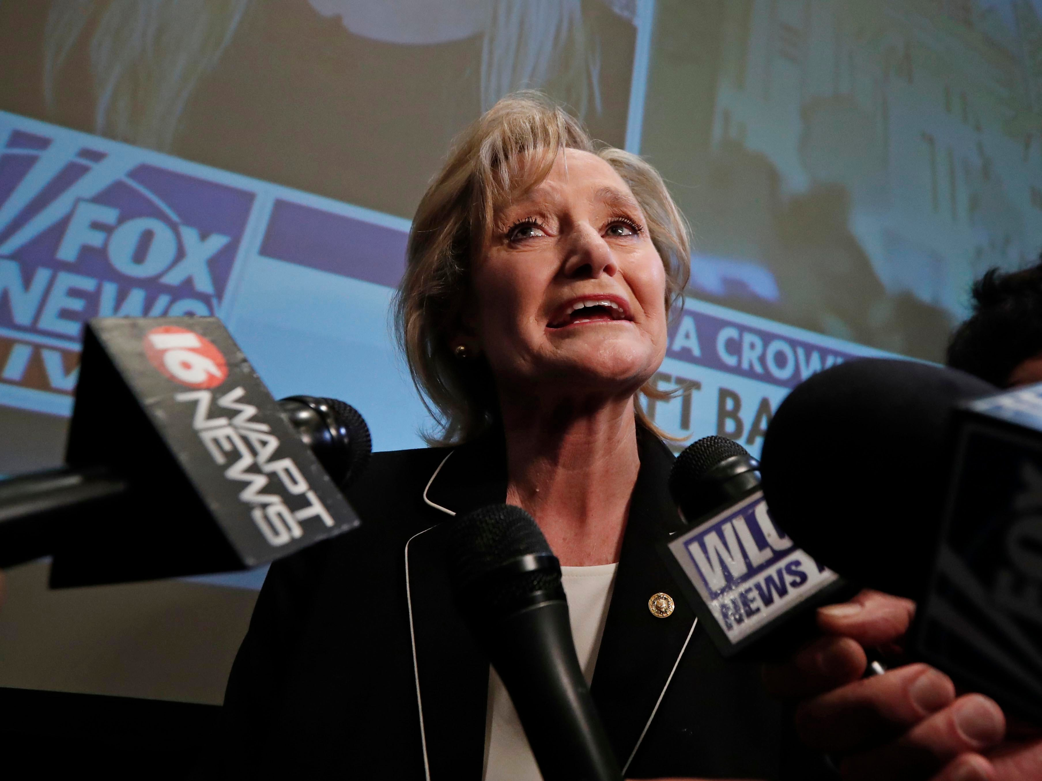 Republican U.S. Sen. Cindy Hyde-Smith speaks to reporters as she celebrates her runoff win over Democrat Mike Espy in Jackson, Miss., Tuesday, Nov. 27, 2018. Hyde-Smith will now serve the final two years of retired Republican Sen. Thad Cochran's six year term. (AP Photo/Rogelio V. Solis)