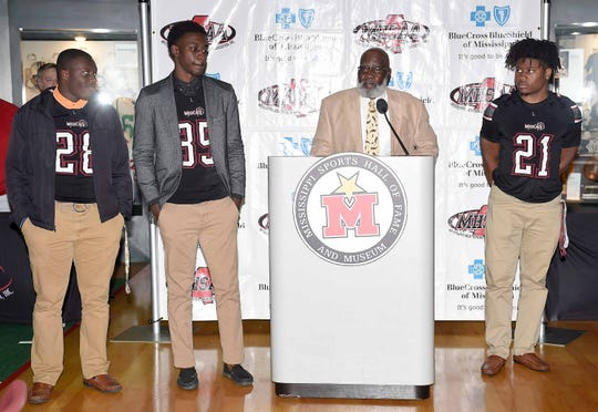 Louisville head coach M.C. Miller and players Derius Hopkins (28), Ashanti Cistrunk (35) and Kevon Jackson (21) met with the media at Monday's state championships press conference at at the Mississippi Sports Hall of Fame.