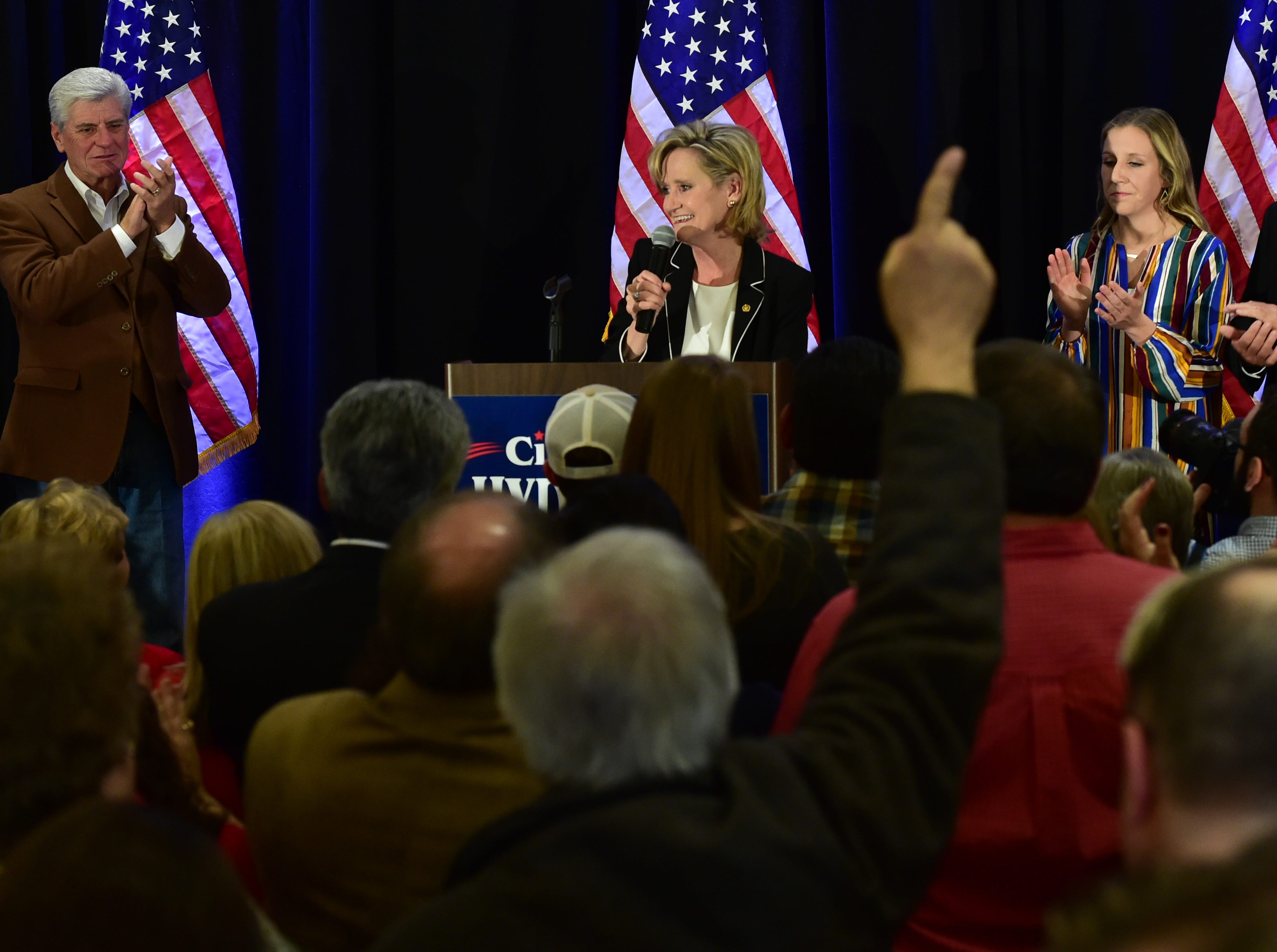 U.S. Sen. Cindy Hyde-Smith gives her acceptance speech to attendees of her senate campaign runoff watch party at the Westin Hotel in Jackson, Miss. She was joined on stage by family and Miss. Gov. Phil Bryant. Tuesday, Nov. 27, 2018.
