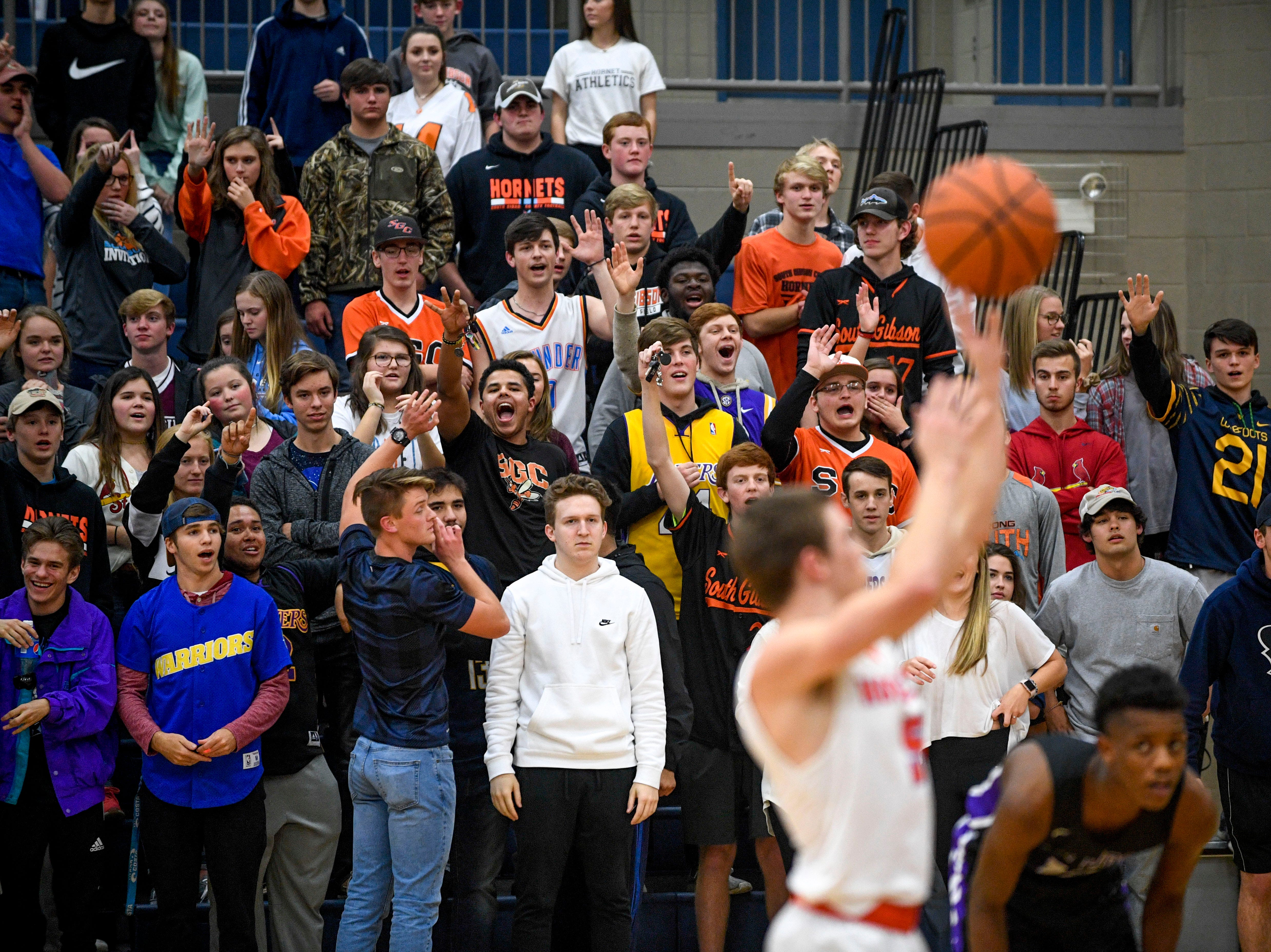 South Gibson fans cheer on Nathan Hicks (5) while shooting a penalty shot that will secure them the lead in a TSSAA boys basketball game between South Gibson and Haywood High Schools at South Gibson High School in Medina, Tenn., on Tuesday, Nov. 27, 2018.
