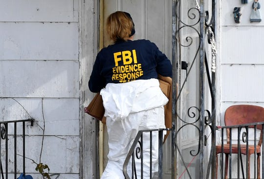 An FBI Evidence Response Team agent walks into the old home of Cayce McDaniel in Milan on Wednesday, Nov. 28, 2018. Agents were called in to assist in the 22-year-old missing persons case of McDaniel by searching and collecting evidence in the home.