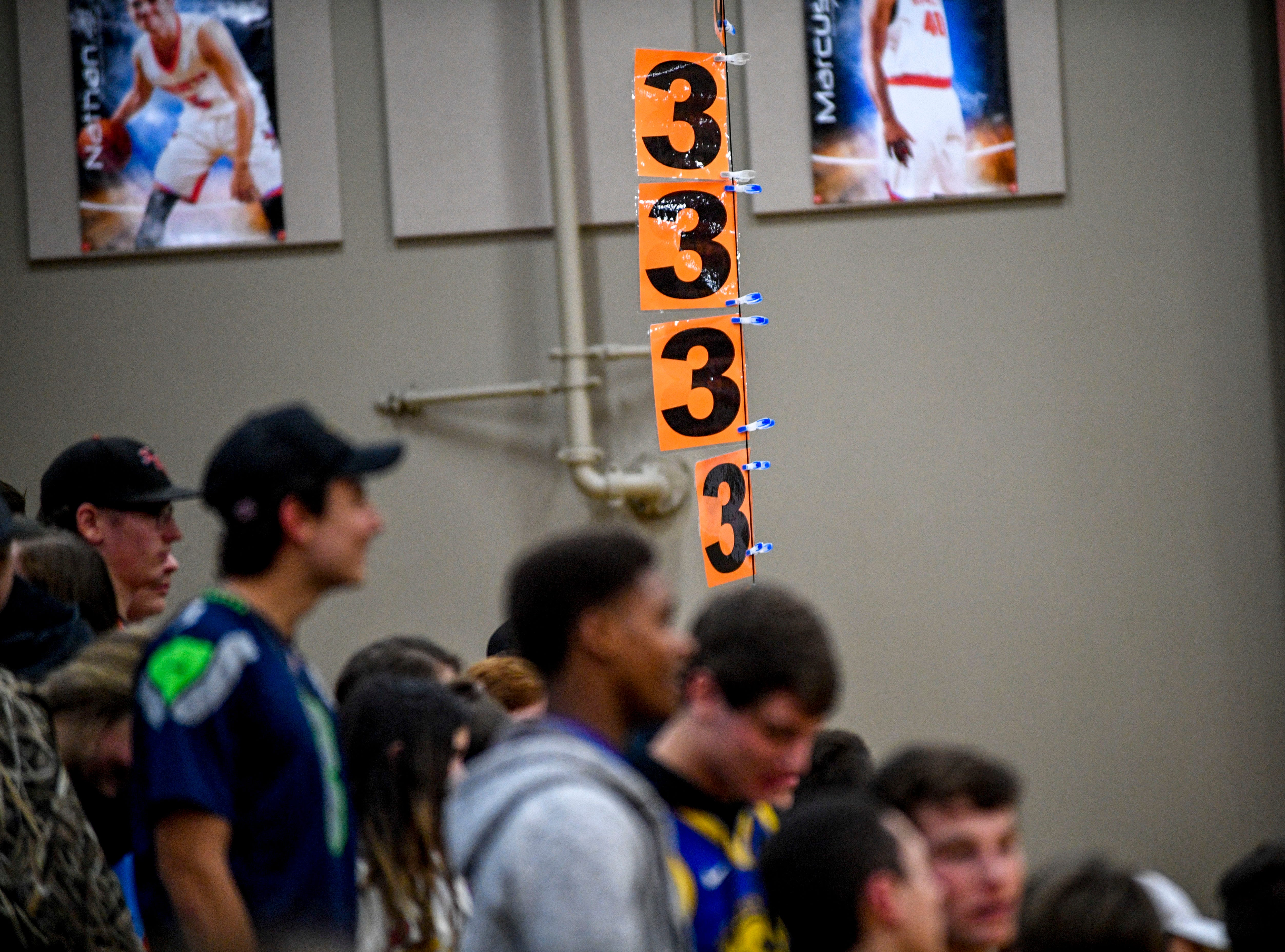 "A balloon with string dangling from it holds up a large ""3"" representing each three point shot the South Gibson players made that was put up by the student section in a TSSAA boys basketball game between South Gibson and Haywood High Schools at South Gibson High School in Medina, Tenn., on Tuesday, Nov. 27, 2018."