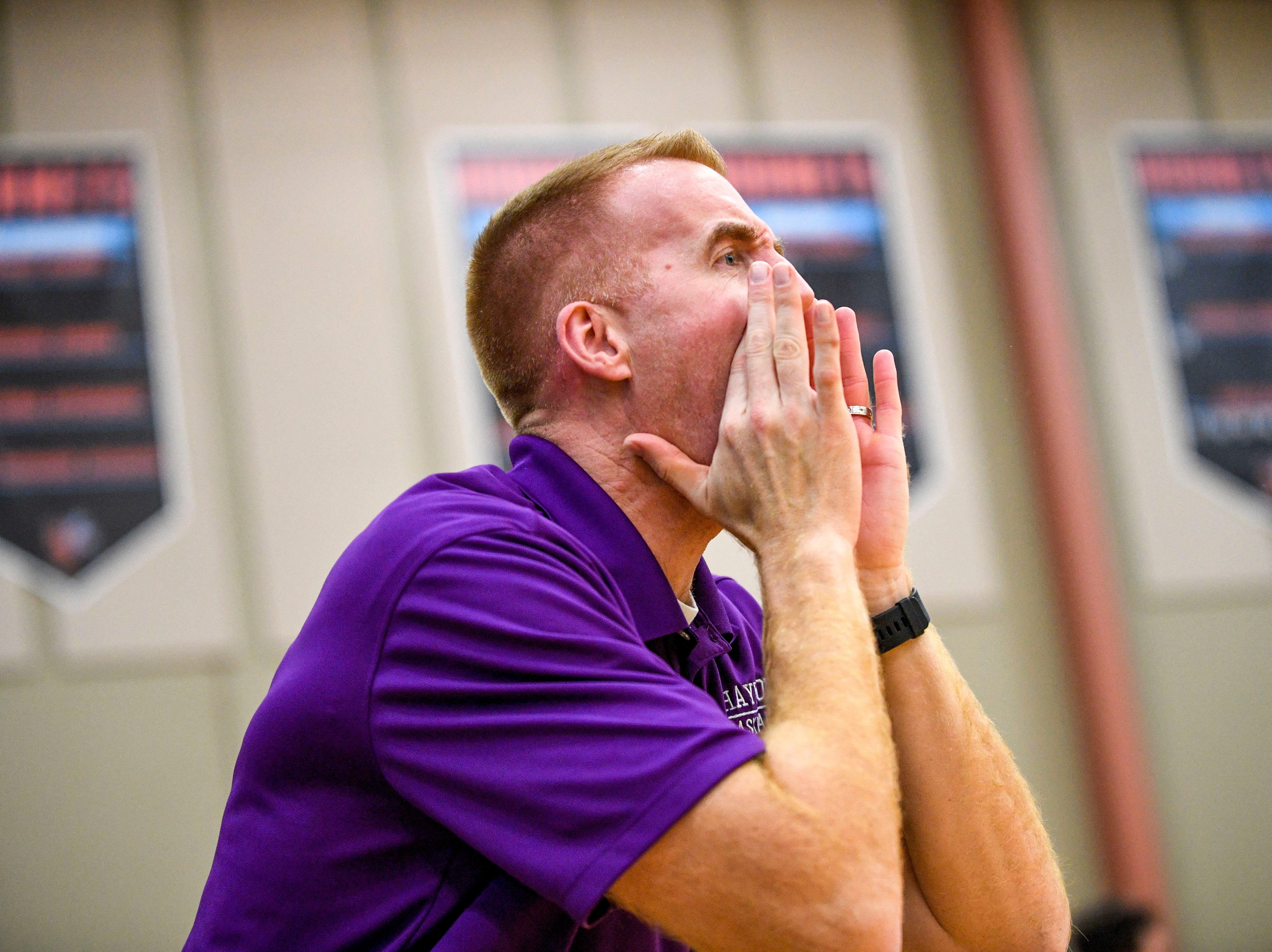 Haywood head coach Oliver Simmons yells to his team from the sidelines in a TSSAA boys basketball game between South Gibson and Haywood High Schools at South Gibson High School in Medina, Tenn., on Tuesday, Nov. 27, 2018.
