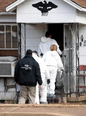 FBI Evidence Response Team agents walk into the old home of Cayce McDaniel in Milan, Wednesday, November 28. Agents were called in to assist in the over 20 year old missing persons cold case of McDaniel by searching and collecting evidence in the home where it is reported she went missing from.