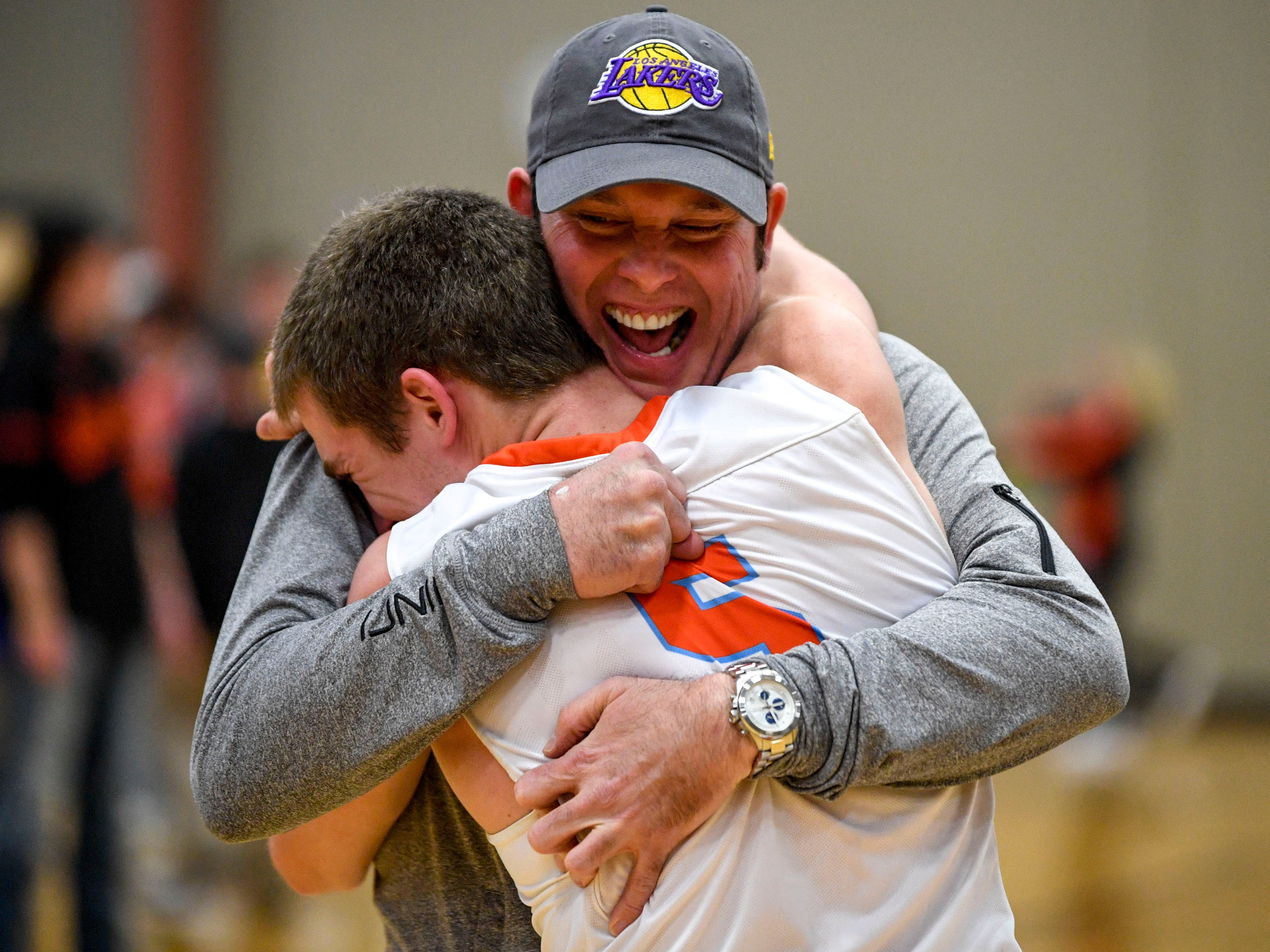 South Gibson's Nathan Hicks (5) embraces his father David Hicks after winning a TSSAA boys basketball game between South Gibson and Haywood High Schools at South Gibson High School in Medina, Tenn., on Tuesday, Nov. 27, 2018.