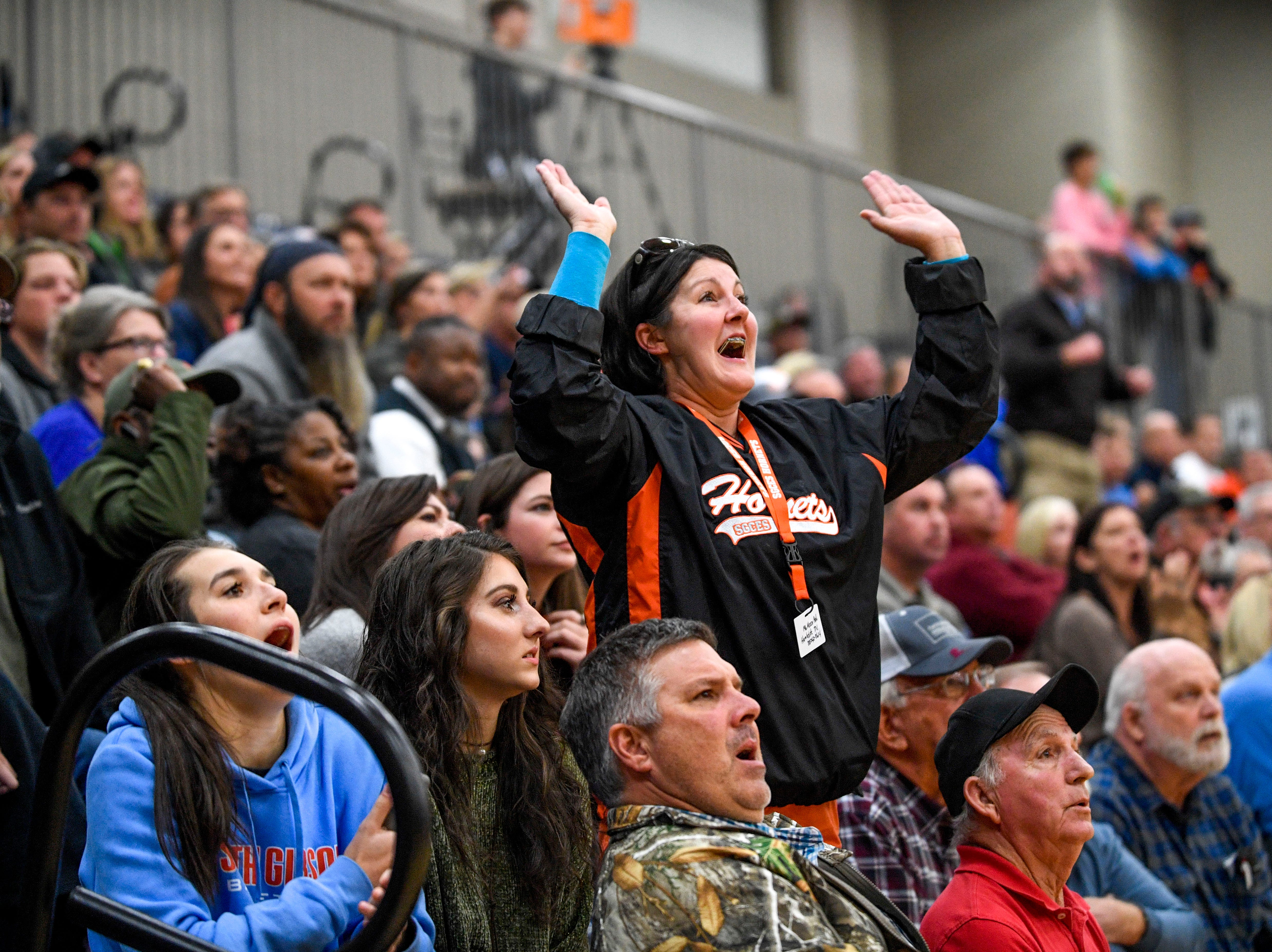 South Gibson fans stand up and cheer for their team in a TSSAA boys basketball game between South Gibson and Haywood High Schools at South Gibson High School in Medina, Tenn., on Tuesday, Nov. 27, 2018.