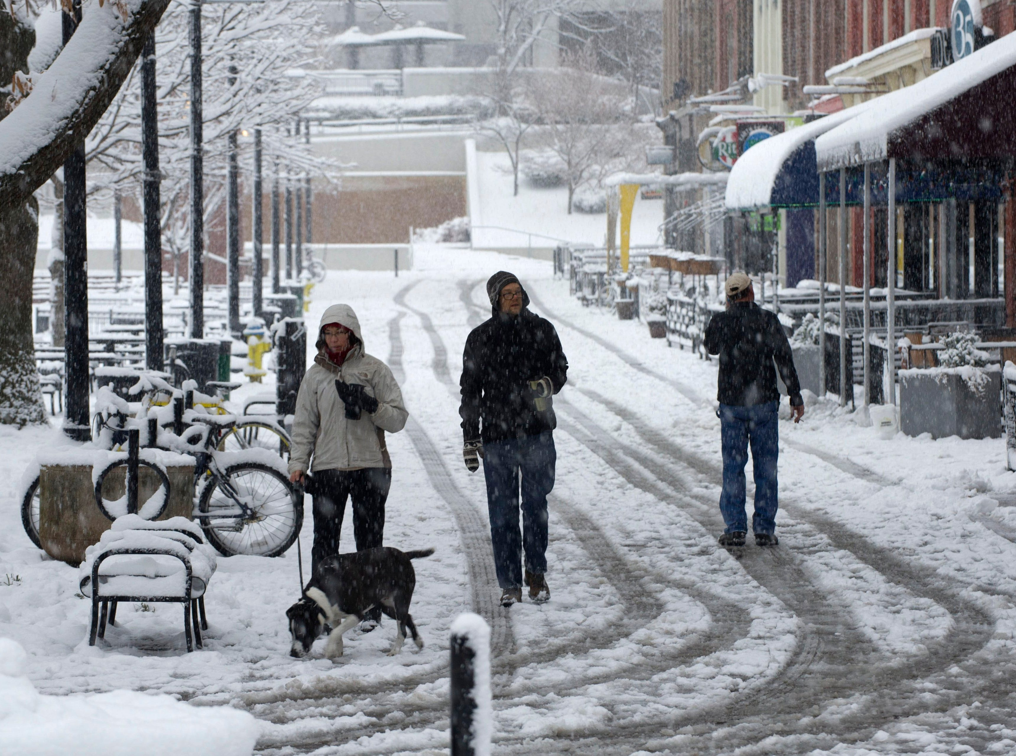 Downtown residents walking on Market Square Mall in downtown Knoxville early Thursday Feb. 13, 2014.